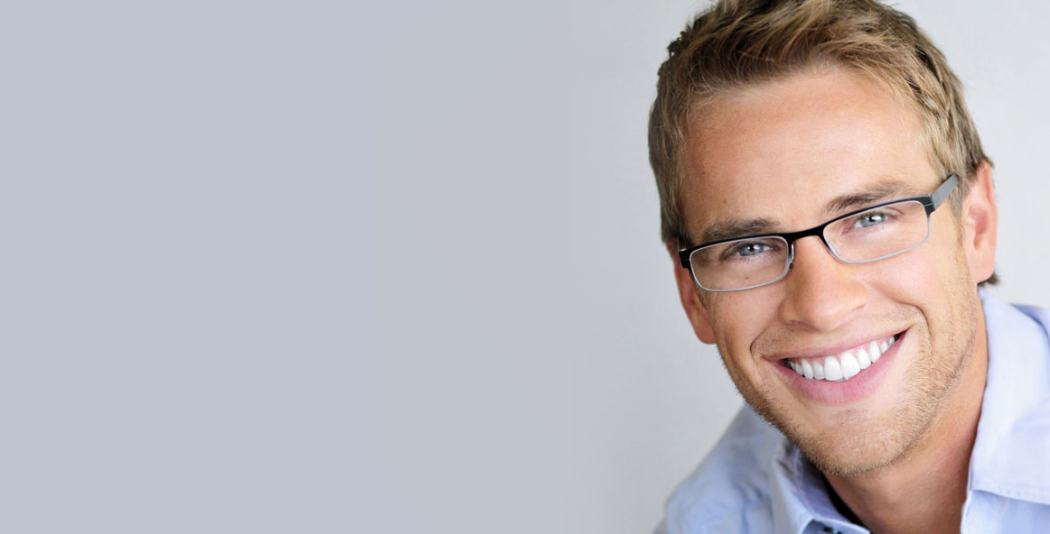 handsome man with clean simple glasses smiling